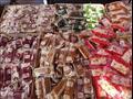 الكيلو بـ35 جنيهًا والبيع بالقطعة.. حلاوة المولد الشعبية تغزو أسواق بورسعيد-صور