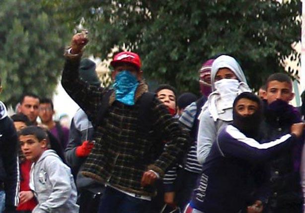الاشتباكات بين المحتجين والشرطة تنتشر في مدن تونسية عدة