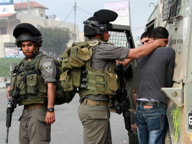 قوات الاحتلال الإسرائيلي تعتقل 20 فلسطينيا من الضفة الغربية